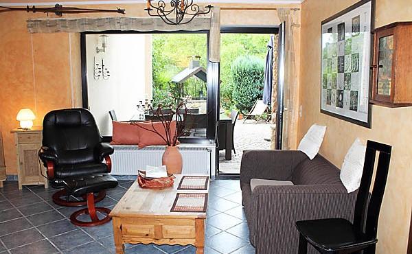 Wohnbereich mit Zugang zur großen Terrasse, Ferienwohnung Weinberg - Urlaubsdomizil Haardter Sonne, Neustadt / Weinstr. (Pfalz)