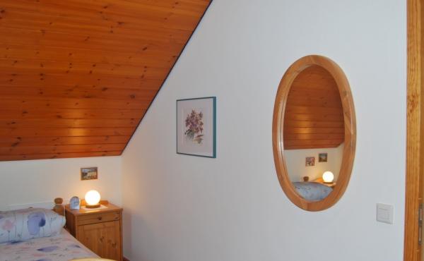 Schlafzimmer mit Spiegel